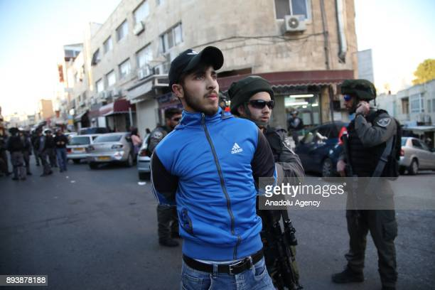 Israeli forces detain a Palestinian man during a protest against US President Donald Trumps announcement to recognize Jerusalem as the capital of...