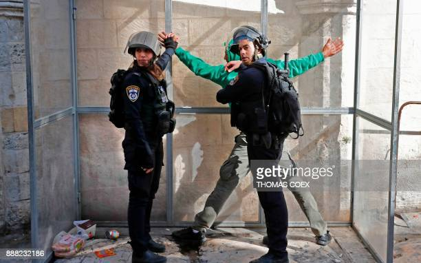 TOPSHOT Israeli forces detain a Palestinian man in Jerusalem's Old City on December 8 2017 Israel deployed hundreds of additional police officers...
