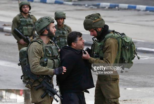 TOPSHOT Israeli forces detain a Palestinian protester during clashes that followed protests against a decision by US President Donald Trump to...