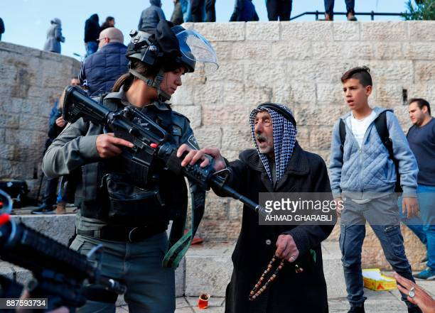 TOPSHOT Israeli forces disperse Palestinian protestors outside Damascus Gate in Jerusalem's Old City on December 7 2017 US President Donald Trump's...