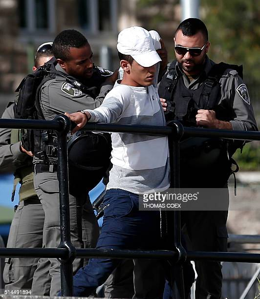 Israeli forces frisk a Palestinian young man at Damascus Gate of Jerusalem's Old City on March 9 2016 / AFP / THOMAS COEX