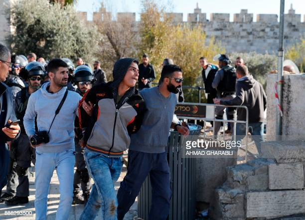 Israeli forces in plain clothes detain a Palestinian man at Damascus Gate in Jerusalem's Old City on December 8 2017 Israel deployed hundreds of...