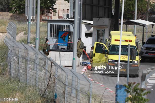 Israeli forces inspect site after a Palestinian youth was shot dead by Israeli forces following an alleged stabbing attempt at a checkpoint in...