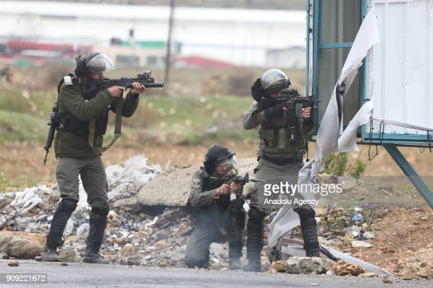 Israeli forces intervene in a protest against US decision to recognize Jerusalem as Israel's capital near Beit El Checkpoint in Ramallah West Bank on...