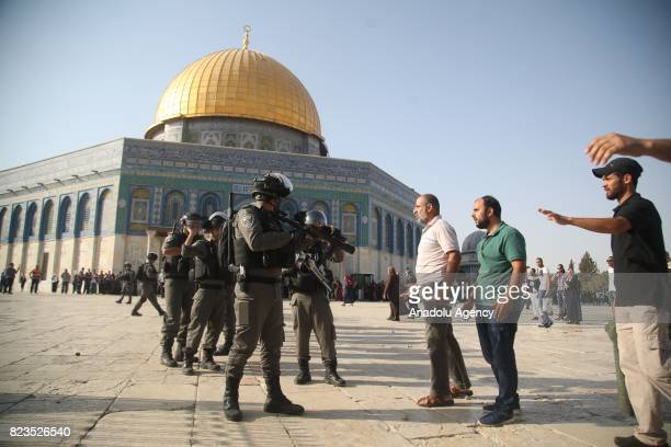 Israeli forces intervene in Palestinian worshippers as they entered the Al Aqsa Mosque following the removal of Israeli security measures near the...