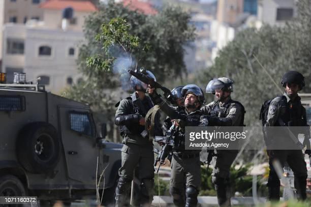Israeli forces intervene in Palestinians during an Israeli raid in Ramallah West Bank on December 10 2018