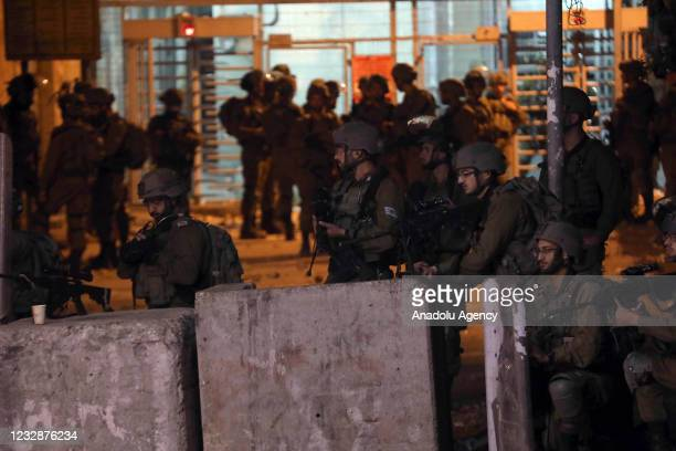 Israeli forces intervene in Palestinians with tear gas canisters, plastic and real bullets during a protest against Israeli attacks in Jerusalem and...