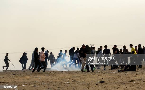 Israeli forces intervene in Palestinians with tear gas during a protest within the Great March of Return demonstration near IsraelGaza border in...