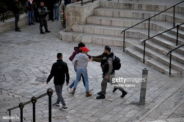Israeli forces intervene in protesters during protest against U.S. President Donald Trumps announcement to recognize Jerusalem as the capital of...