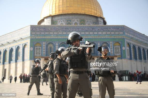 Israeli forces intervene Palestinian worshippers as they gather to enter the Al Aqsa Mosque following the removal of Israeli security measures near...