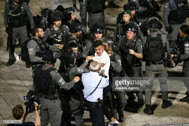 Israeli forces intervene Palestinian young Muslims, who gathered after performing Tarawih prayer, with water cannon vehicles and sound bombs in...