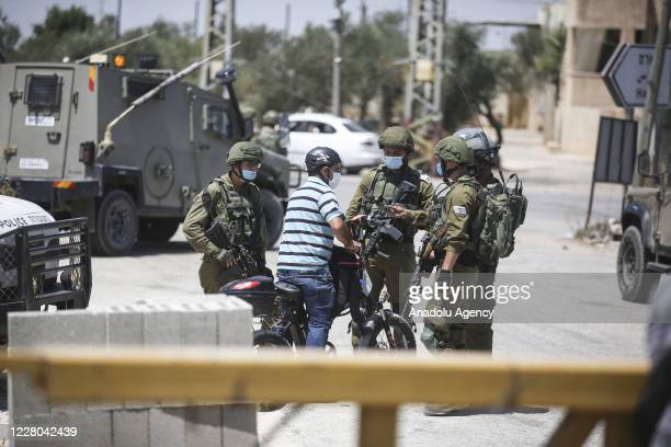 Israeli forces intervene Palestinians gathering to stage a protest against the agreement between United Arab Emirates' and Israel to deal...