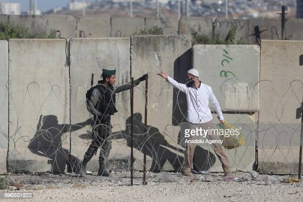 Israeli forces intervene the Palestinian worshippers as they try to move for passing through the Qalandiya checkpoint from Ramallah into Jerusalem...