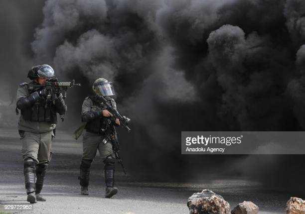 Israeli forces intervene to Palestinian demonstrators near Beit El Checkpoint during a protest against the Jewish settlements separation wall and US...