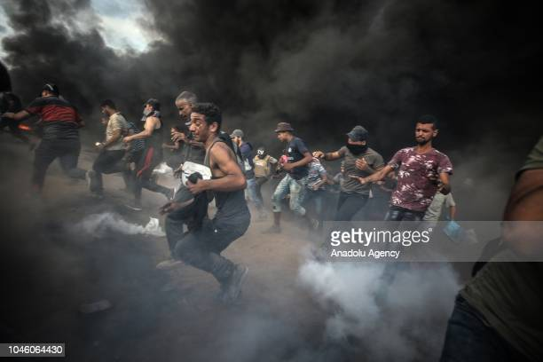 Israeli forces intervene to Palestinian demonstrators using tear gas during the Great March of Return demonstration near IsraelGaza border in east of...