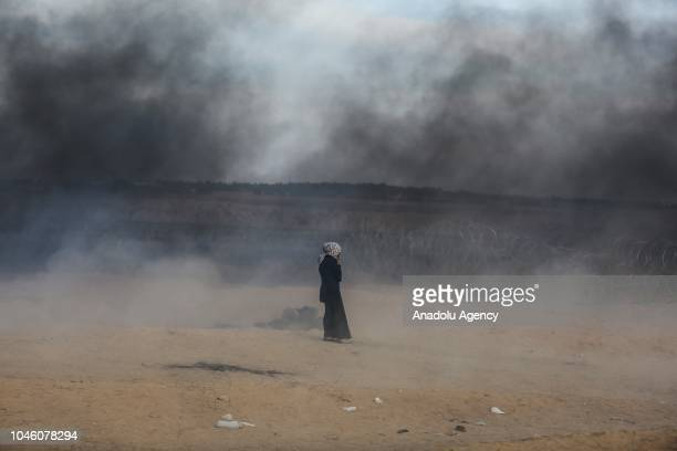 "Israeli forces intervene to Palestinian demonstrators using tear gas during the ""Great March of Return"" demonstration near Israel-Gaza border, in..."
