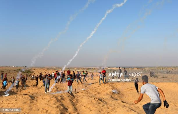 Israeli forces intervene to Palestinian demonstrators using tear gas during a demonstration within the Great March of Return at IsraelGaza border in...