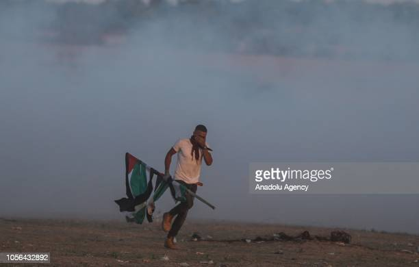 Israeli forces intervene to Palestinian demonstrators with tear gas during the Great March of Return demonstration in Khan Yunis Gaza on November 2...