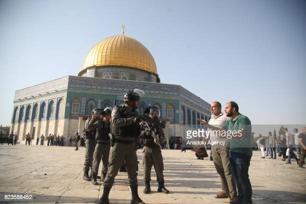 Israeli forces intervene to Palestinians with tear gas bomb as they gather to enter the Al Aqsa Mosque following the removal of Israeli security...