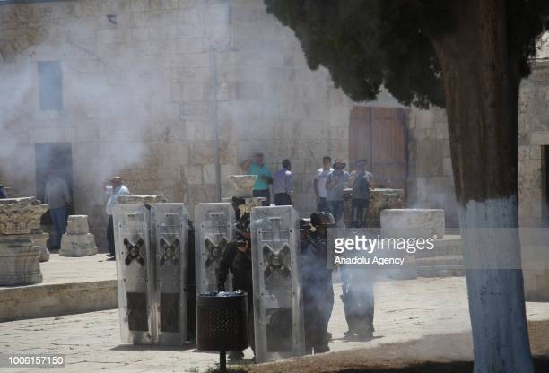 Israeli forces launch a tear gas canister to disperse worshipers during a protest against intervention of Israeli forces after they entered East...