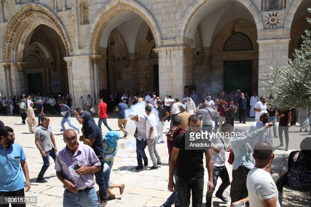 Israeli forces launch a tear gas canister to disperse worshippers during a protest against intervention of Israeli forces after they entered East...