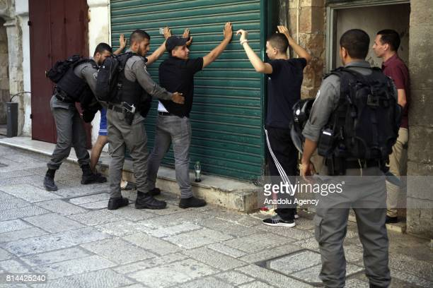 Israeli forces perform an identity check on Palestinians around The Old City after three Palestinian men's who were allegedly attempted a shooting...
