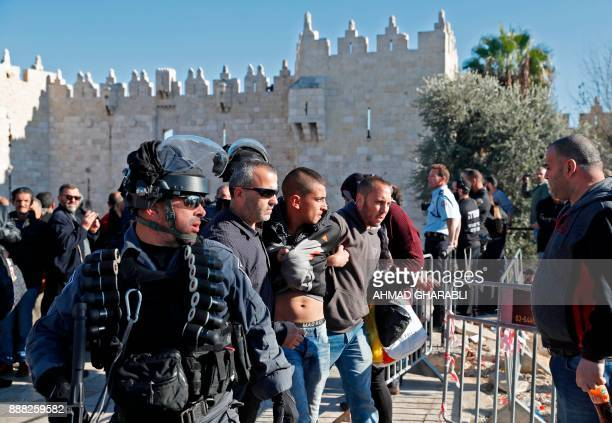 Israeli forces scuffle with Palestinians at Damascus Gate in Jerusalem's Old City on December 8 2017 Israel deployed hundreds of additional police...