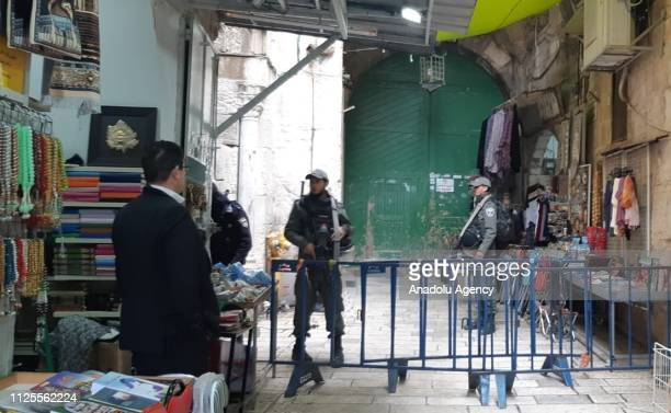 Israeli forces stand guard behind a barricade as they shut all gates of East Jerusalem's flashpoint Al Aqsa Mosque on February 18 2019