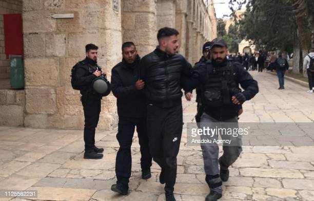 Israeli forces take a Palestinian into custody after shutting all gates of East Jerusalem's flashpoint Al Aqsa Mosque on February 18 2019