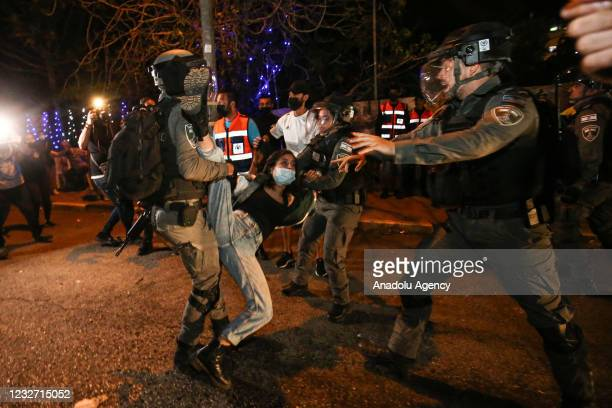 Israeli forces take a Palestinian into custody during a demonstration at Sheikh Jarrah neighborhood after Israeli government's plan to force some...