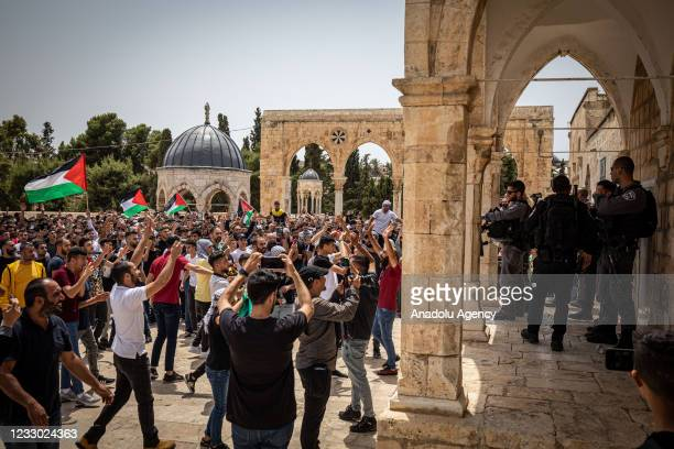 Israeli forces take measures as Palestinians gather at the Dome of the Rock after performing Friday prayer at Al-Aqsa Compound in Jerusalem on May...