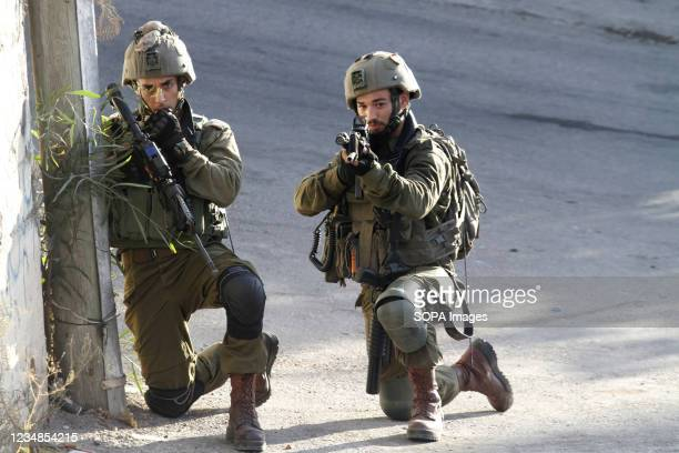Israeli forces take position during a search operation in Salem village, east of Nablus after Palestinians threw stones at a settler car on the road...