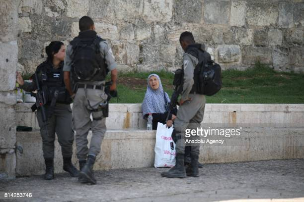 Israeli forces take security measures after Israeli police shot 3 Palestinians who allegedly carried a gun before killed by them near the Lion's Gate...