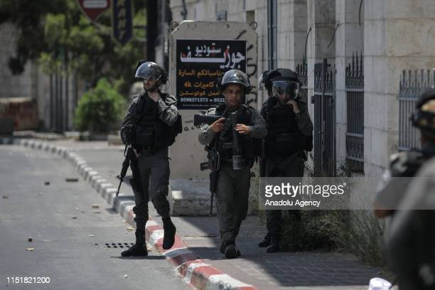 Israeli forces take security measures around the site after a group of people gathered to protest against the USled conference in Bahrain on June 25...