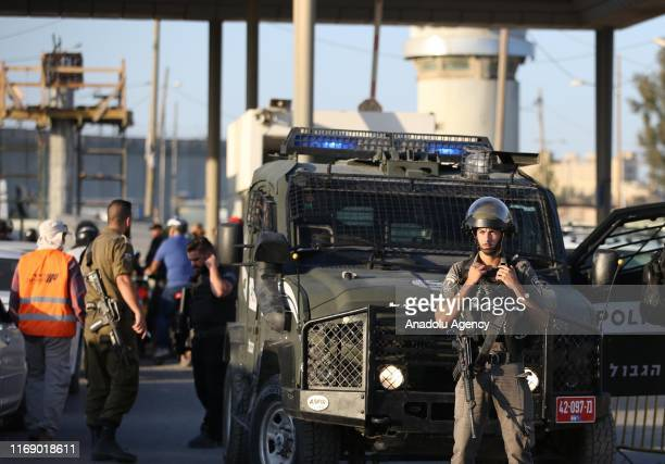 Israeli forces take security measures with blocking road after a Palestinian woman was shot and martyred by them at the Qalandia refugee camp...