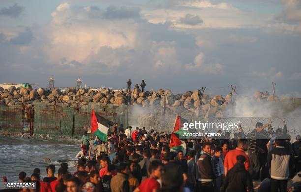 Israeli forces uses tear gas canisters to disperse Palestinians during the 15th 'maritime demonstration' to break the Gaza blockade by sea with...