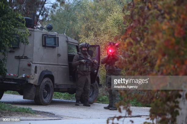 Israeli forces wait at the site after they carried out a raid in the Jenin district of West Bank on January 18 2018