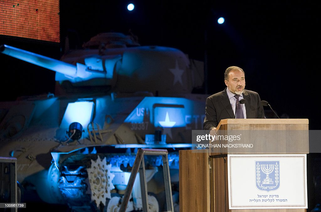 Israeli Foreign Minister Avigdor Lieberman addresses a ceremony honoring World War II veterans and marking the 65th anniversary of the Allied victory over Nazi Germany at the Armored Corps Memorial and Museum at Latrun Junction near Jerusalem on May 25, 2010.