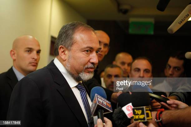 Israeli Foreign Minister Avigdor Lieberman speaks to the press after handing his resignation before arriving for the weekly cabinet meeting at his...