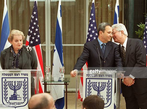 Israeli Foreign Minister David Levy talks with Prime Minister Ehud Barak as United States Secretary of State Madeleine Albright looks on during a...