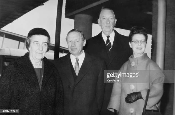 Israeli Foreign Minister Golda Meir arrives at London Airport for talks with the British government 2nd March 1964 With her are Israeli Ambassador to...