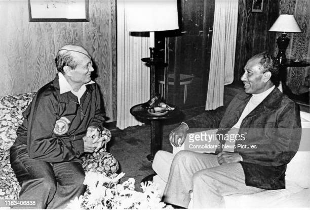 Israeli Foreign Minister Moshe Dayan and Egyptian President Anwar Al Sadat talk together during the EgyptianIsraeli peace negotiations inside Dogwood...