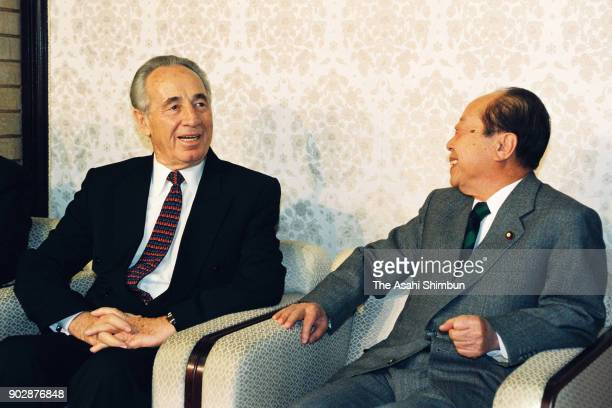 Israeli Foreign Minister Shimon Peres and Japanese Prime Minister Kiichi Miyazawa talk during their meeting at the prime minister's official...