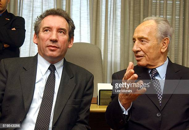 Israeli foreign minister Shimon Peres left gestures during a photo opportunity with French Presidential candidate Francios Bayrou at his office in...
