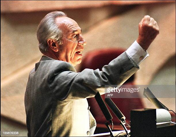 Israeli Foreign minister Shimon Peres raises his fist when reacting to opposition parliament members during a debate at the Knesset 09 September...