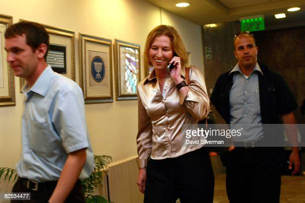 Israeli Foreign Minister Tzipi Livni chats on her cell phone as she arrives for the weekly cabinet meeting August 24 2008 at the Prime Minister's...