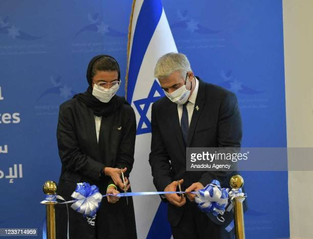 Israeli Foreign Minister, Yair Lapid cuts the ribbon at the opening of Israeli Embassy in Abu Dhabi on June 29, 2021 in Abu Dhabi, United Arab...