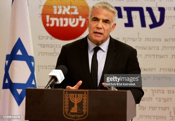 Israeli Foreign Minister Yair Lapid, head of the Yesh Atid party, speaks during a party meeting at the Knesset in Jerusalem on July 5, 2021.