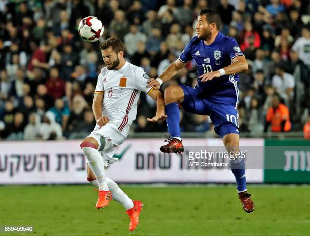 Israeli forward Tomer Hemed vies with Spain's forward Aritz Aduriz during the Russia 2018 FIFA World Cup European Group G qualifying football match...