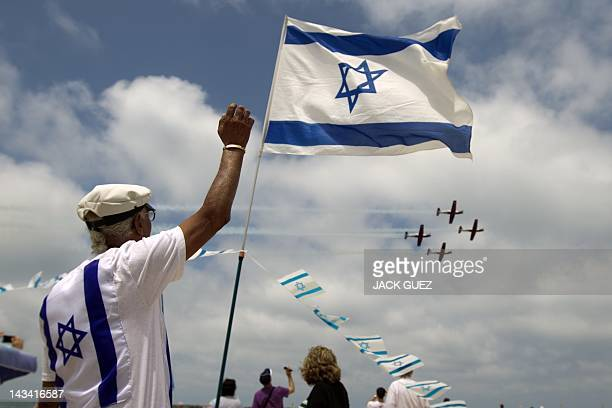 Israeli gather on the beach in the Mediterranean city of Tel Aviv to watch a military show marking Israeli Independence Day on April 26 2012 the 64rd...